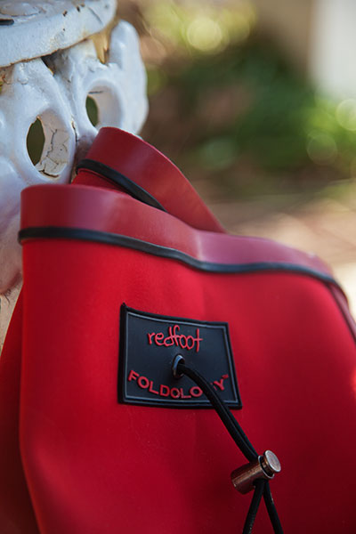 "Green Behavior: ""The Folding Rainboot"" by Redfoot"